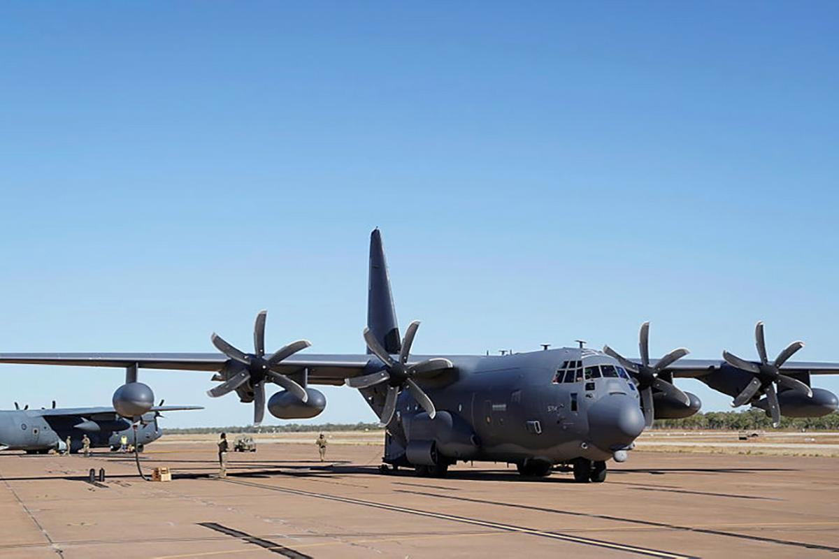A Royal Australian Air Force C-130J Hercules, left, is refuelled from a U.S. MC-130J Air Commando II during a forward area refuelling point training scenario at RAAF Base Tindal during Exercise Talisman Sabre 2021. Photo: 1st Lt. Joshua Thompson