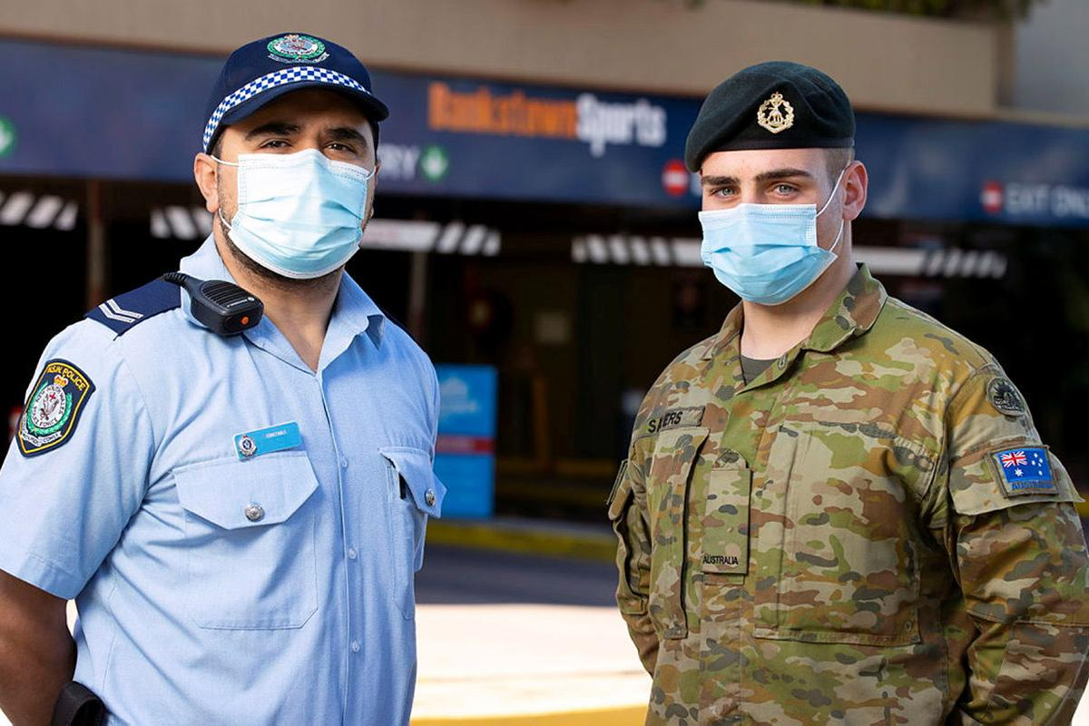 NSW Police and Private Jordan Sayers work together to patrol the Bankstown sports centre in support of the NSW Operation Covid-19 Assist. Photo: Corporal Dustin Anderson