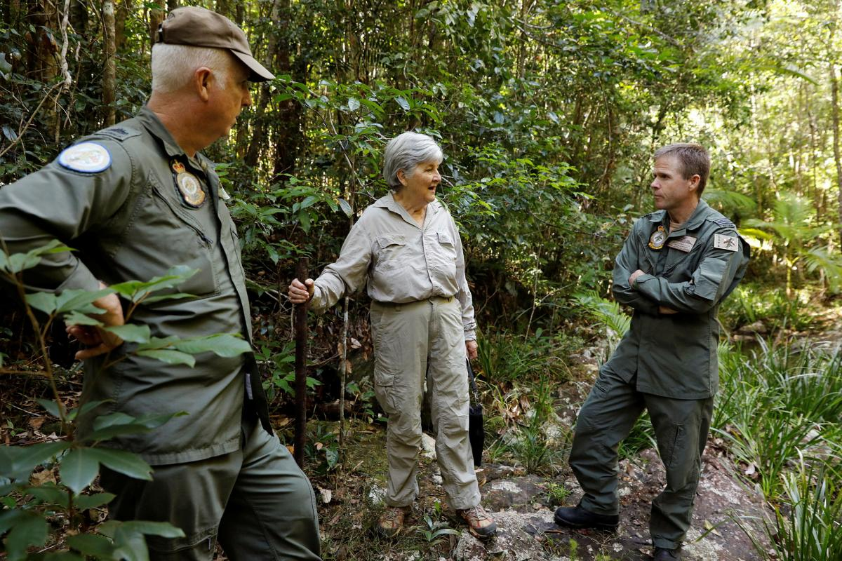 Historian Lynette Silver visits the jungle training area of Air Force's  Combat Survival Training School with instructor Warrant Officer Shane Grist, left, and Commanding Officer Squadron Leader Simon Longley. Photo: Corporal Veronica O'Hara
