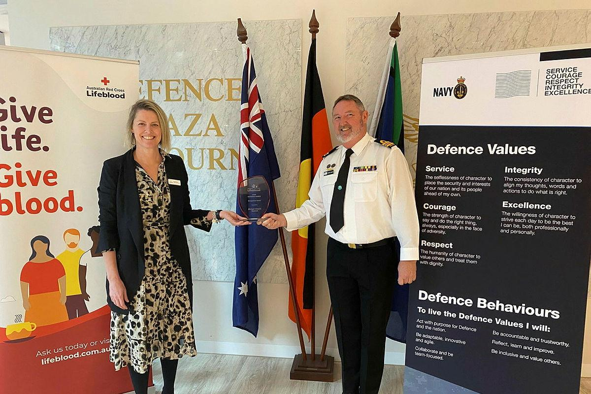 Lieutenant Commander Michael Connors was presented the Lifeblood Defence Force Challenge 2020 award by Lifeblood's Kalani Brown at Defence Plaza in Melbourne.