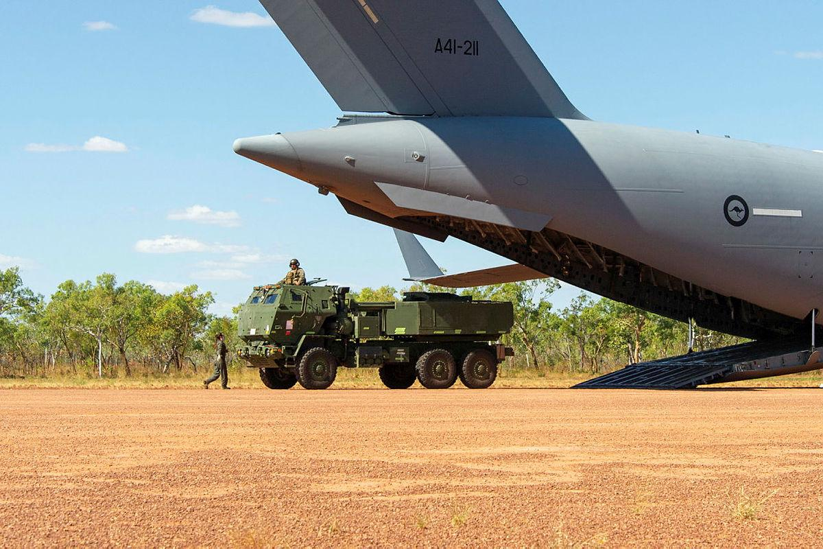 A United States Marine Corps High Mobility Artillery Rocket System is offloaded from a Royal Australian Air Force Boeing C-17 Globemaster III as part of Exercise Loobye. Photo: Captain Carla Armenti