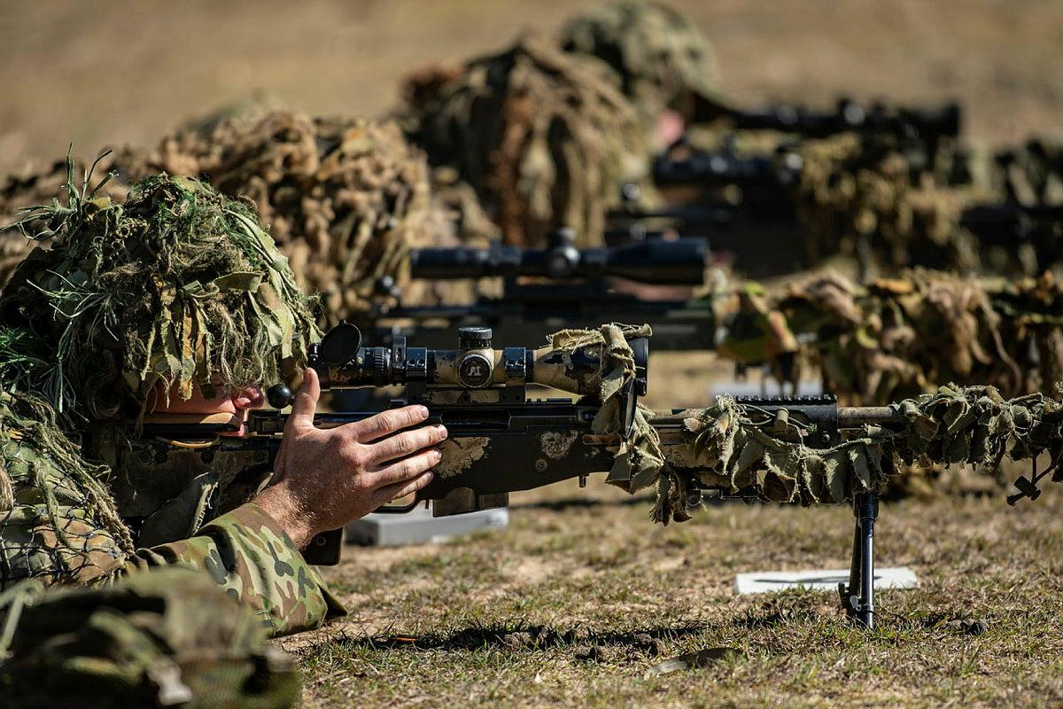 Soldiers from the 6th and 8th/9th Battalions, Royal Australian Regiment, conduct the live-fire phase of the Basic Sniper Course with the SR98 sniper rifle at the Greenbank Training Area. Photo: Private Jacob Hilton