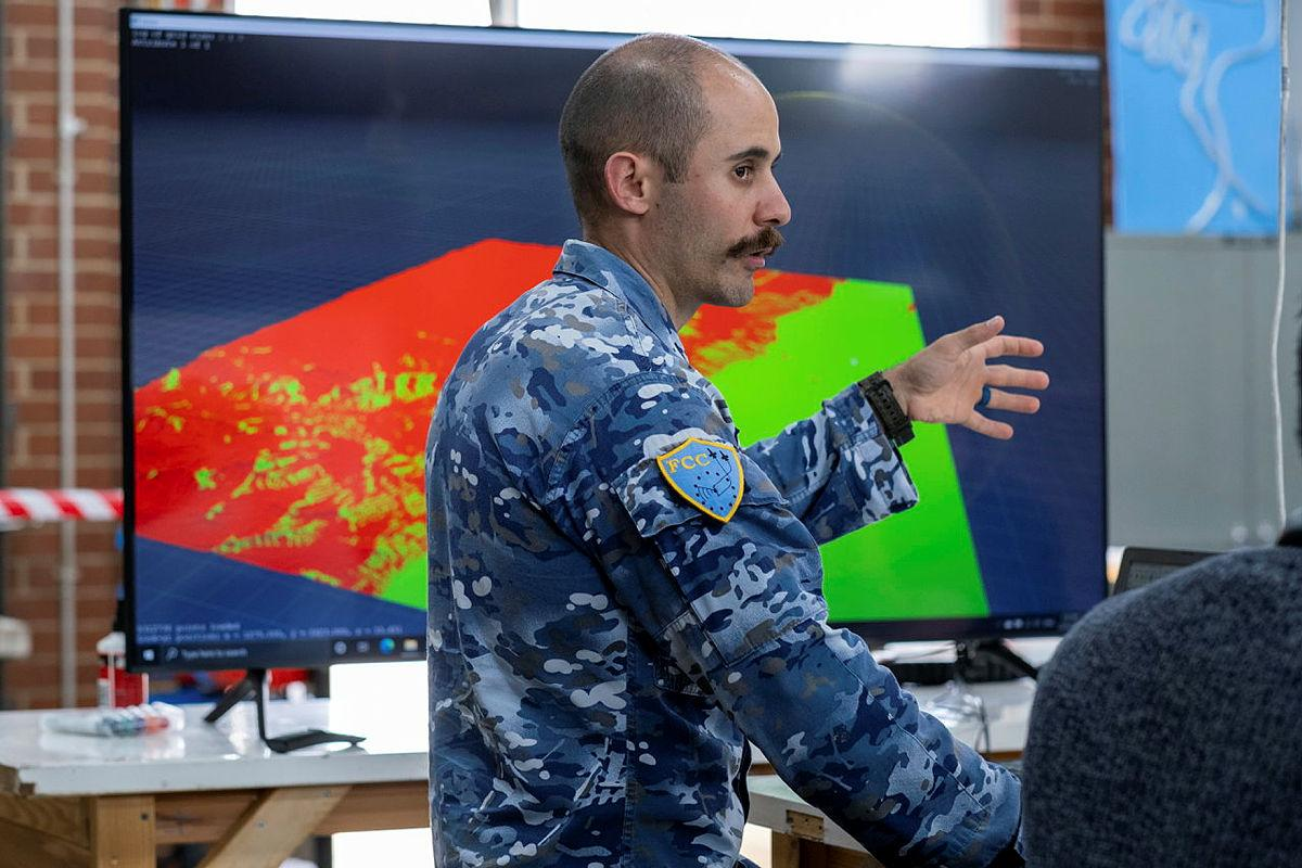 Squadron Leader Ataman Iskender in the Jericho Lab, Canberra, working on the Site Survey program. Photo: Jessica Conway