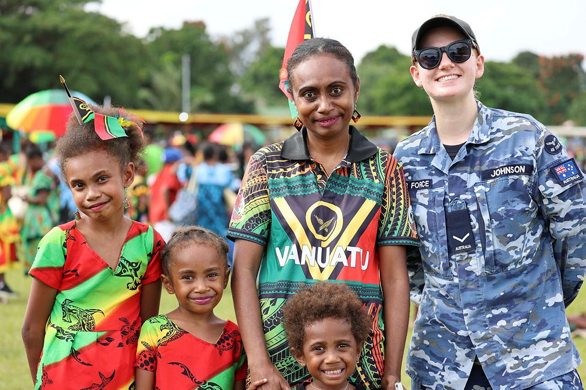 Leading Aircraftwoman Natasha Johnson, from No. 35 Squadron, mingled with locals at the Vanuatu Independence Day parade while deployed on Operation Solania.