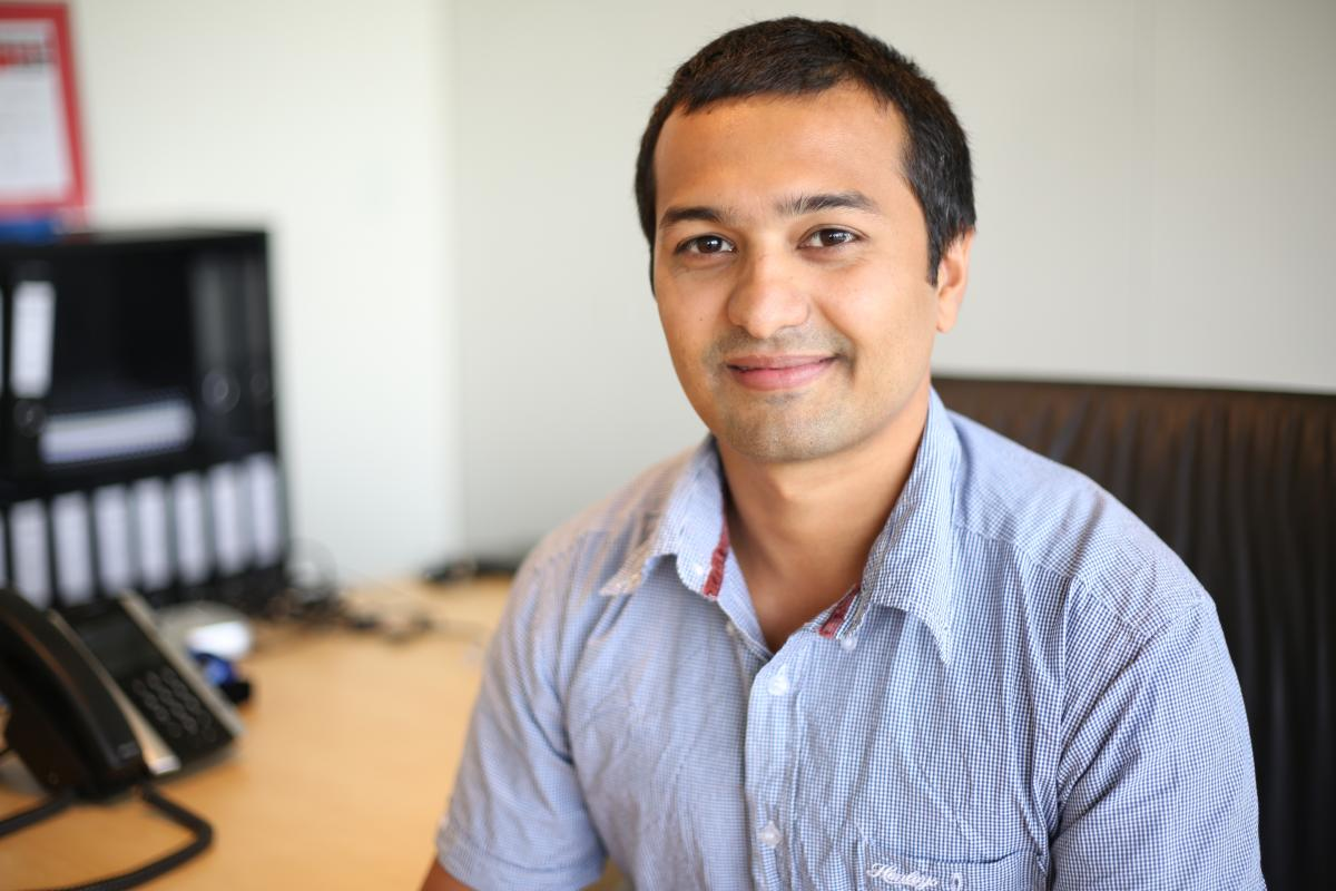 Army reservist Private Varun Marwaha working in his civilian job as an air quality consultant with SLR Consulting.