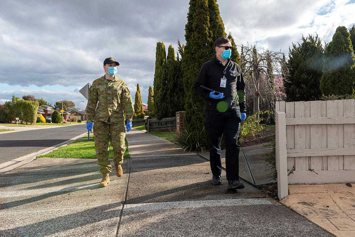 Private Amanda Jones and Victorian Department of Health Authorised Officer Peter Jarvis are part of the COVID-19 Household Engagement Program in support of the Victorian State Government's response to the COVID-19 pandemic. Photo: Private Michael Currie