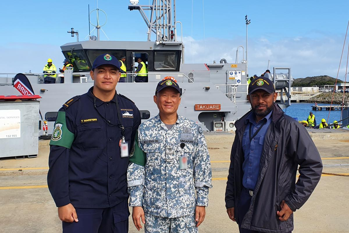 Police Constable Tehapai Marsters (Cook Islands), Warrant Officer Edwin Ong (Singapore) and Chief Petty Officer Timoci Tokaru (Fiji) on the wharf at HMAS Stirling ahead of training with the Sea Training Group - Defence Cooperation Program.