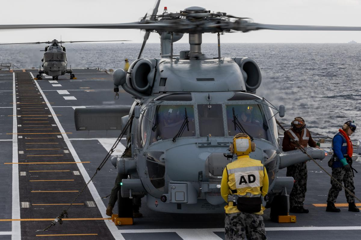 Royal Malaysian Navy Super Lynx and RAN MH-60R helicopters perform deck landing exercises on board HMAS Canberra as part of the Malaysia-Australia Training Exercise. Photo: Petty Officer Christopher Szumlanski