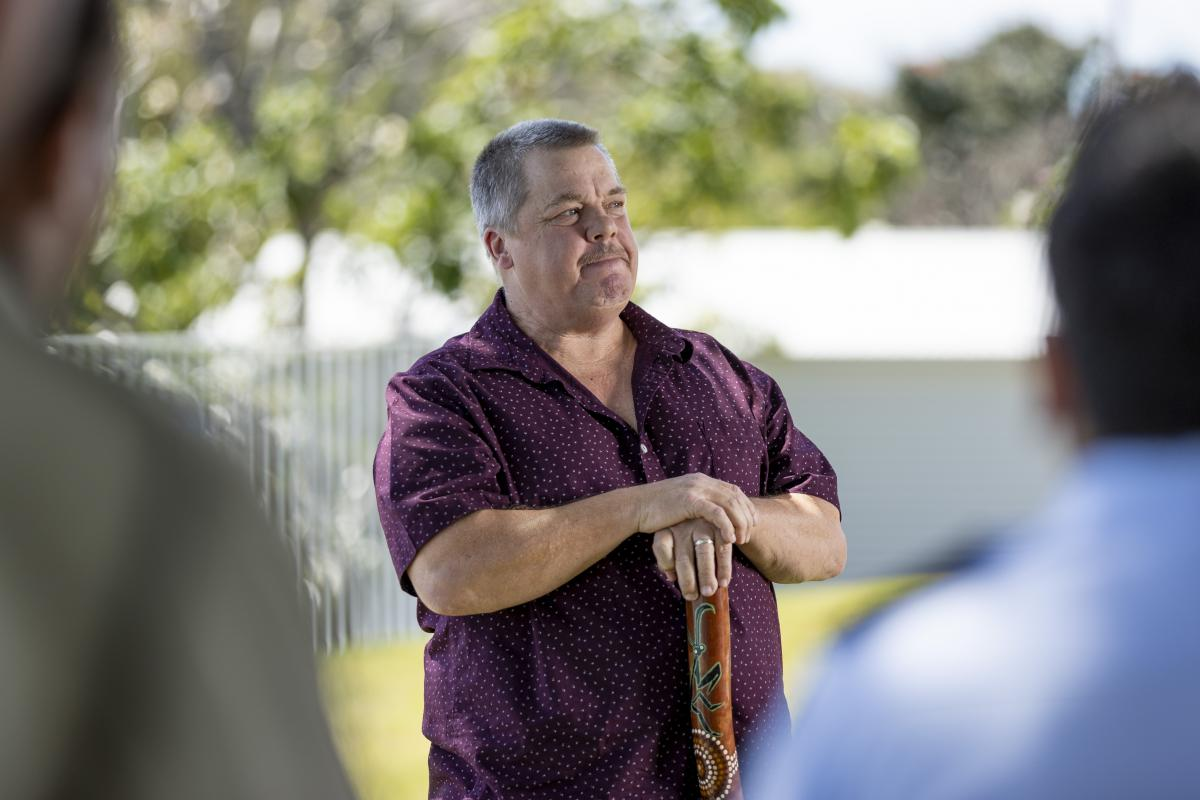 Indigenous elder David Boye speaks to guests during his enlistment ceremony in Townsville. Photo: Corporal Brodie Cross