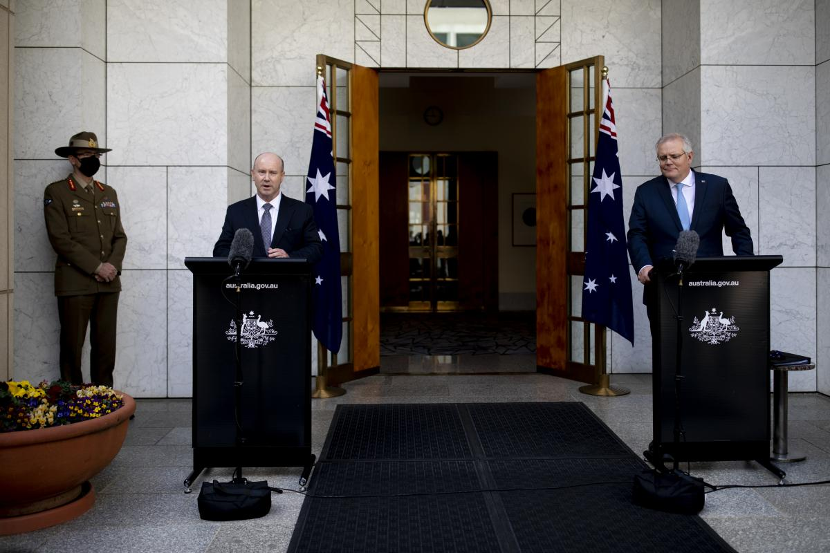 From Left, Chief of the Defence Force General Angus Campbell, Secretary of Defence Greg Moriarty and Prime Minister Scott Morrison announce the AUKUS alliance and nuclear submarine acquisition at Parliament House, Canberra yesterday. Photo: Jay Cronan