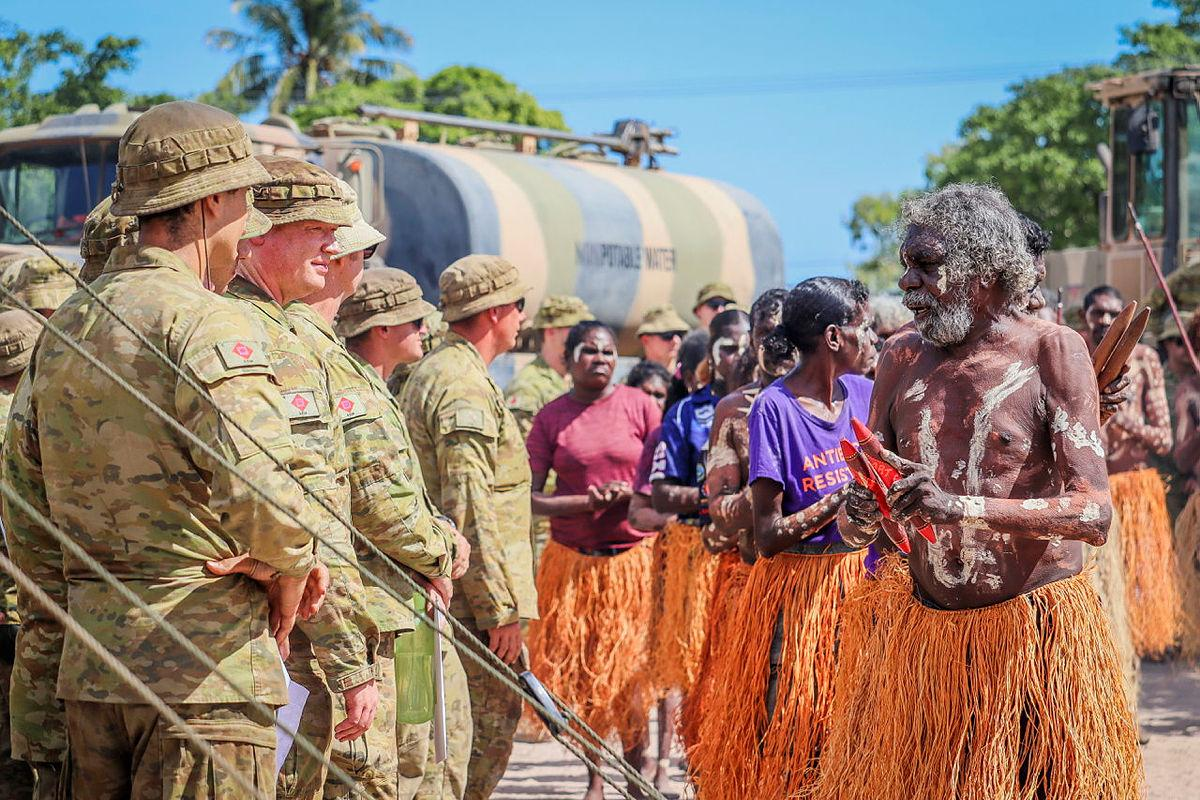 Members of the Pormpuraaw Arts Centre Dance Group greet the Army contingent during the AACAP 2021 opening ceremony.