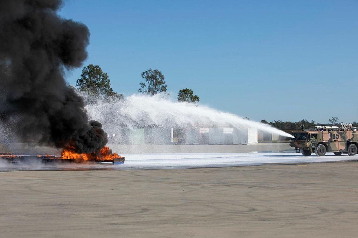 Air Force's No. 23 Squadron Aviation Rescue and Fire Fighting personnel apply fluorine-free foam to extinguish a large demonstration aviation fuel blaze. Photo: Sergeant Andrew Eddie