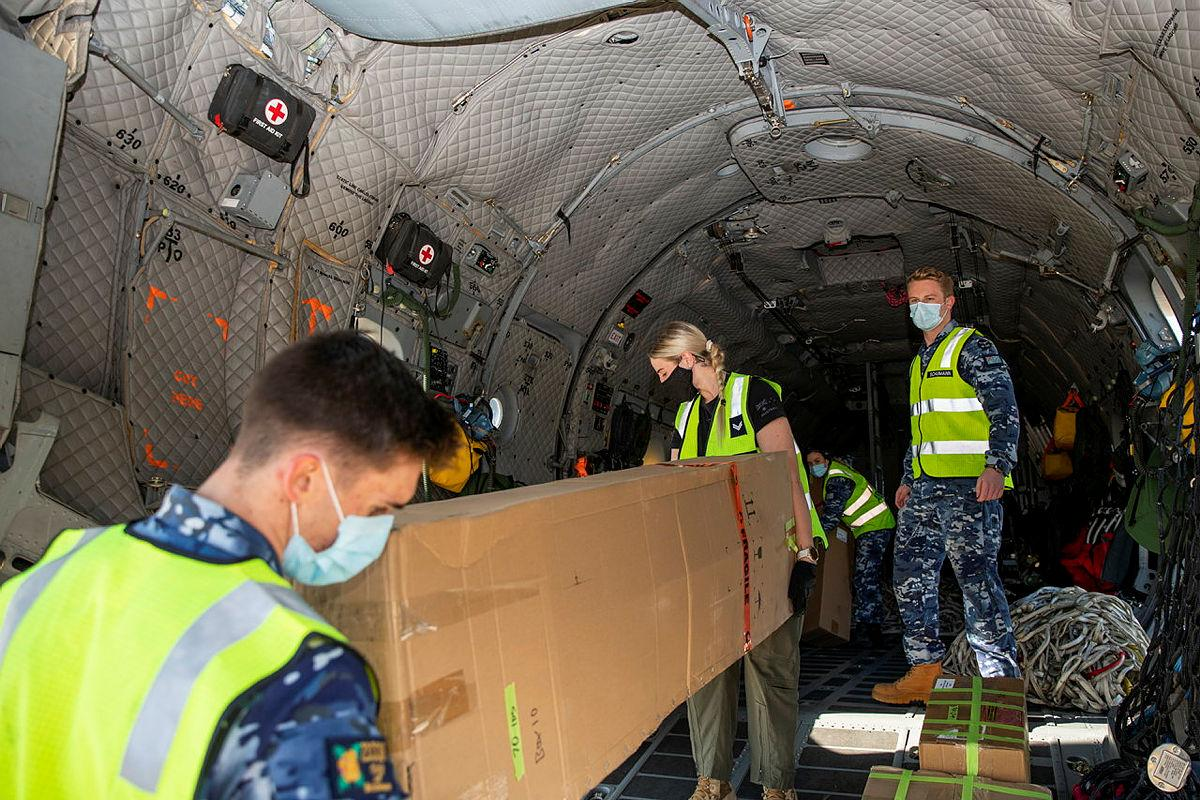 Air movements operators from No. 23 Squadron and loadmasters from No. 35 Squadronload engineering equipment bound for Fiji onto an Air Force C-27J Spartanat RAAF Base Amberley. Photo: Leading Aircraftwoman Emma Schwenke