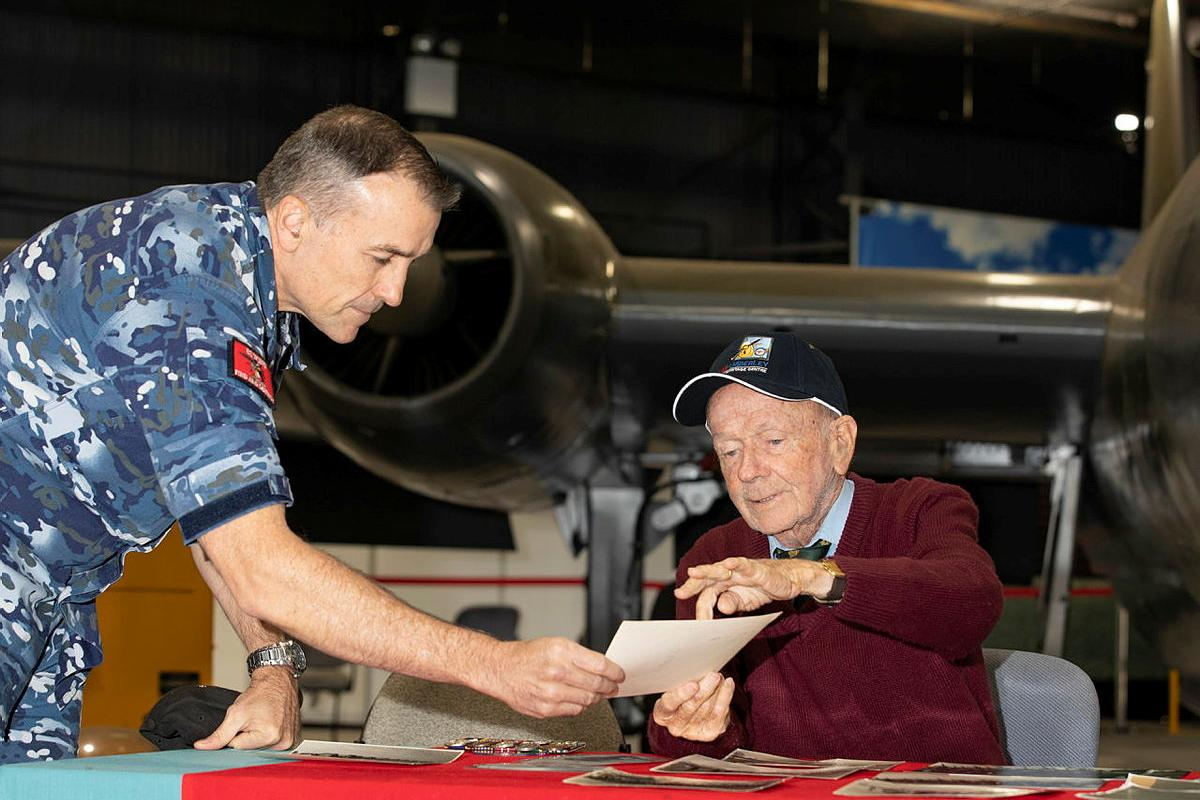 """Bryan """"Mick""""McShane, right, shares some of his memories of the Air Force with Warrant Officer Russell Beck at the RAAF Base Amberley Aviation Heritage Centre. Photo: Corporal Jesse Kane"""