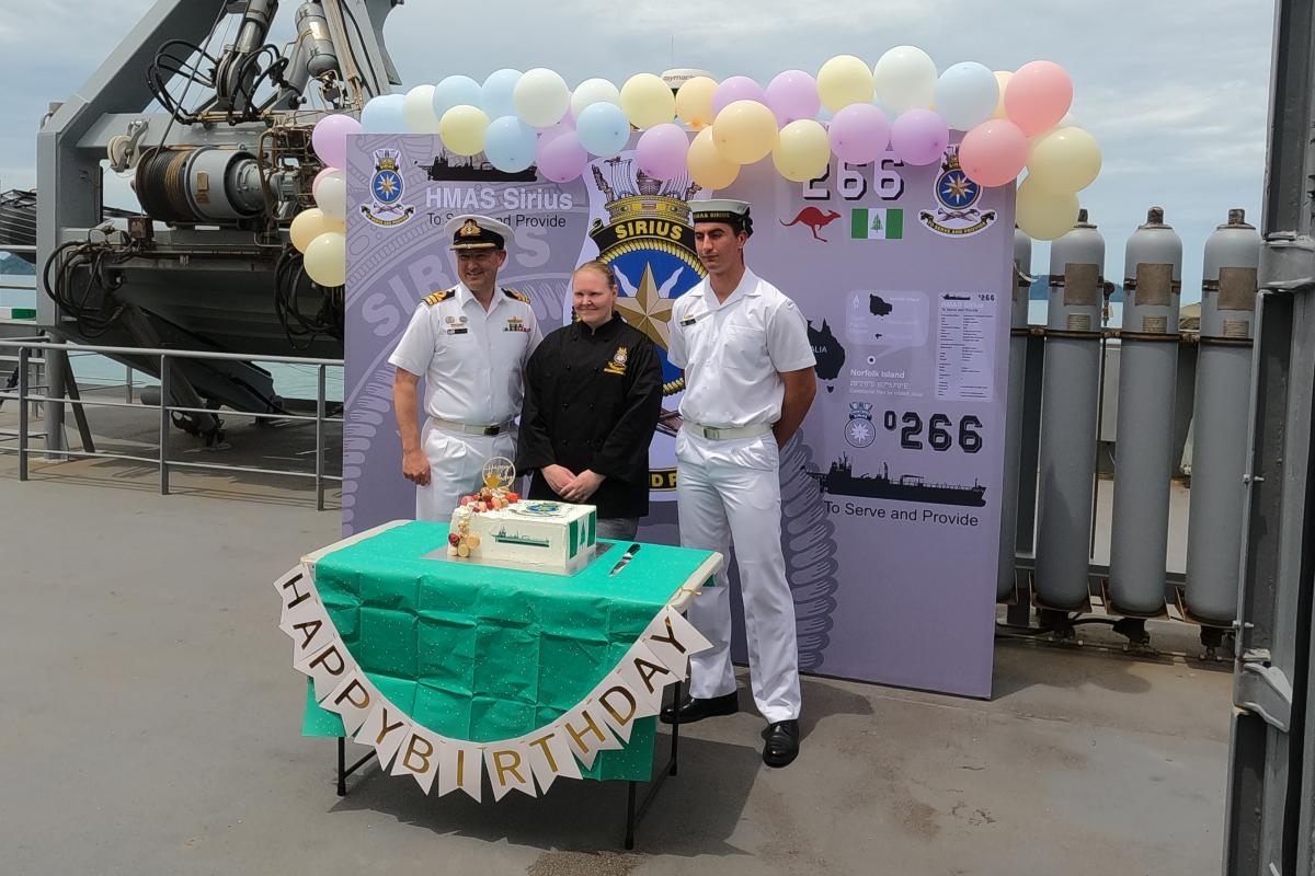 Commanding Officer HMAS Sirius Commander Chris Doherty, left, Leading Seaman Esler Cartledge and SeamanLeroy O'Connor celebrate the ship's 15th birthday.