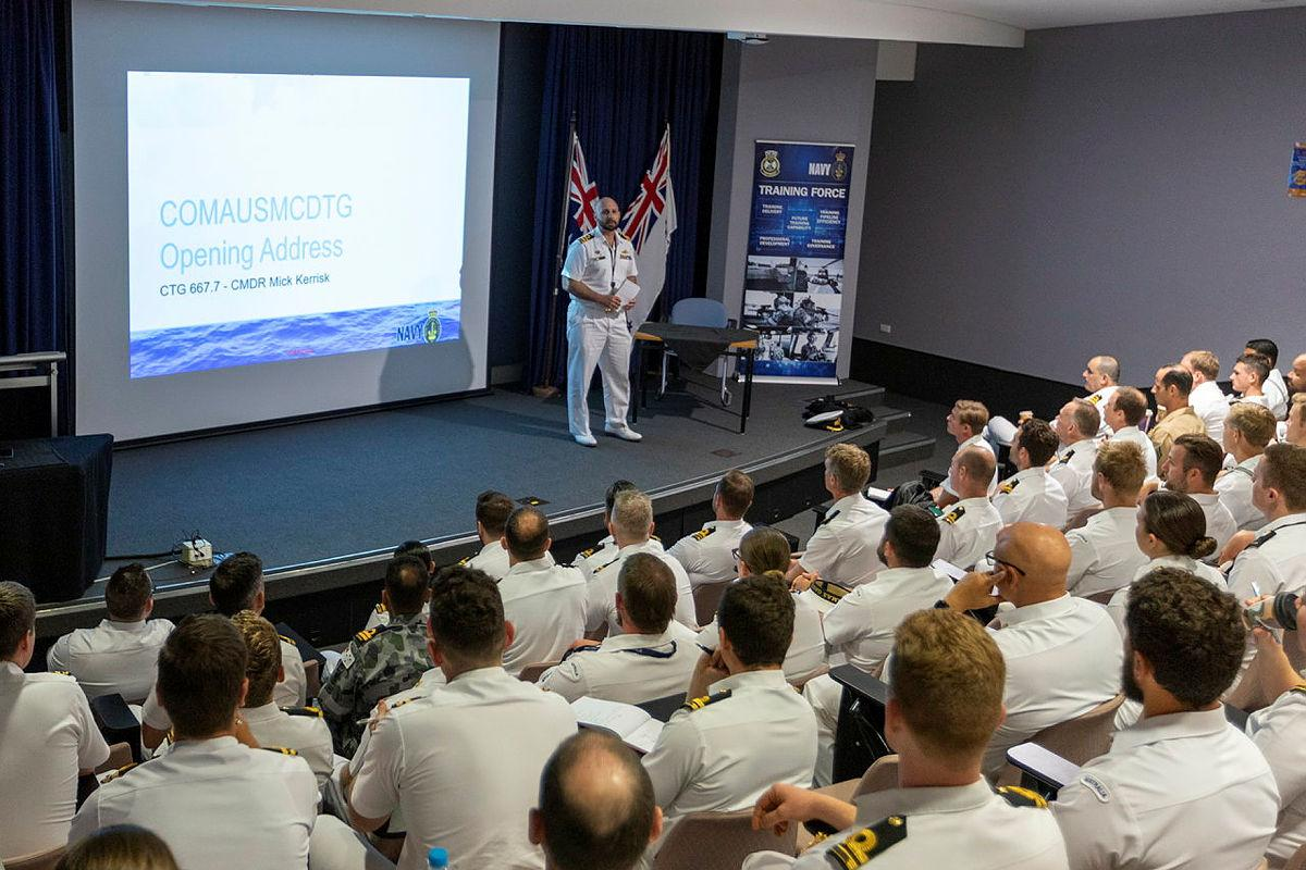 Commander Australian Mine Warfare and Clearance Diving Task Group, Commander Micheal Kerrisk, delivers the opening address to Australian and American personnel participating in Exercise Dugong 2021. Photo: Leading Seaman Ronnie Baltoft
