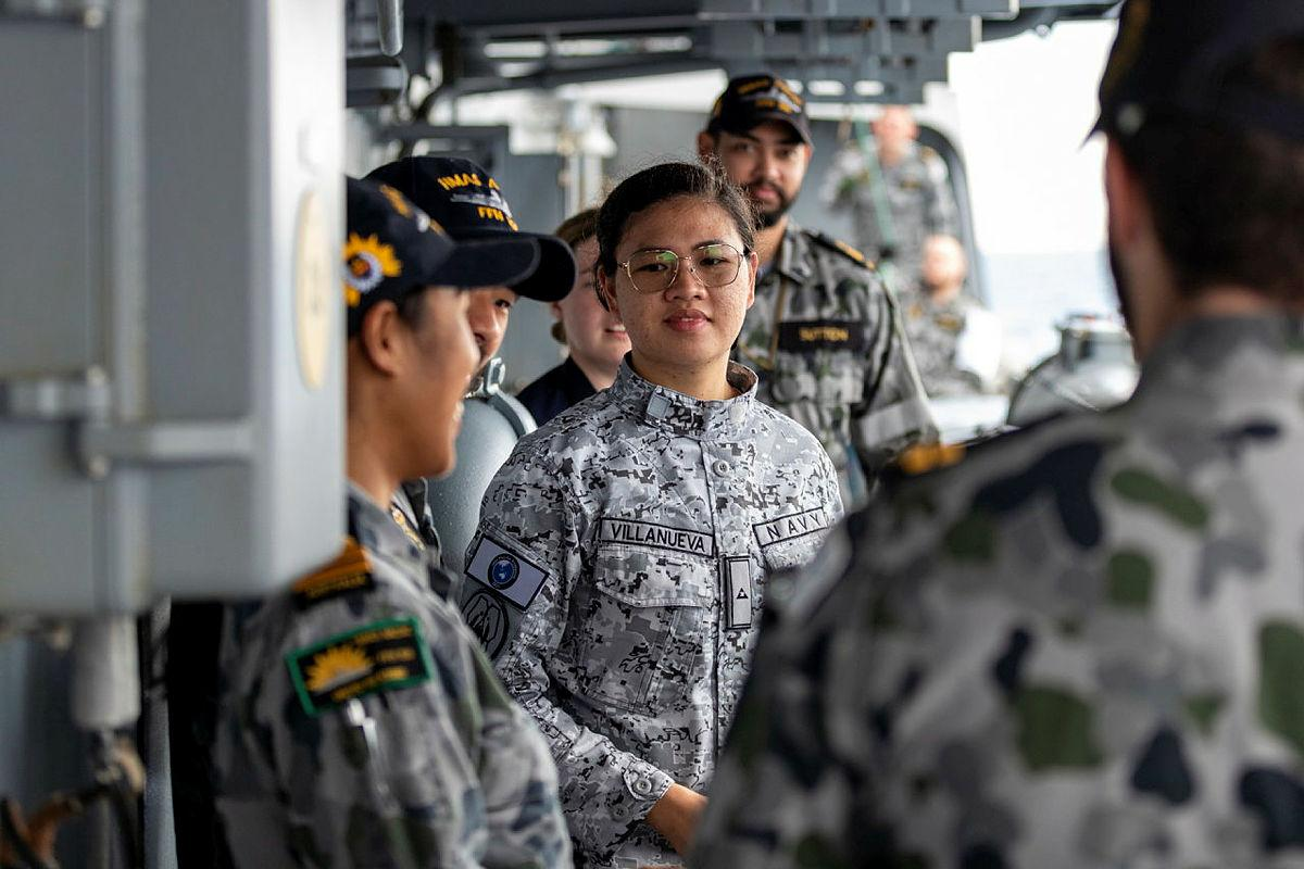 A Philippine Navy officer is greeted on boardHMAS Anzac during a cross-deck exchange as part of Indo-Pacific Endeavour 21. Photo: Leading Seaman LeoBaumgartner