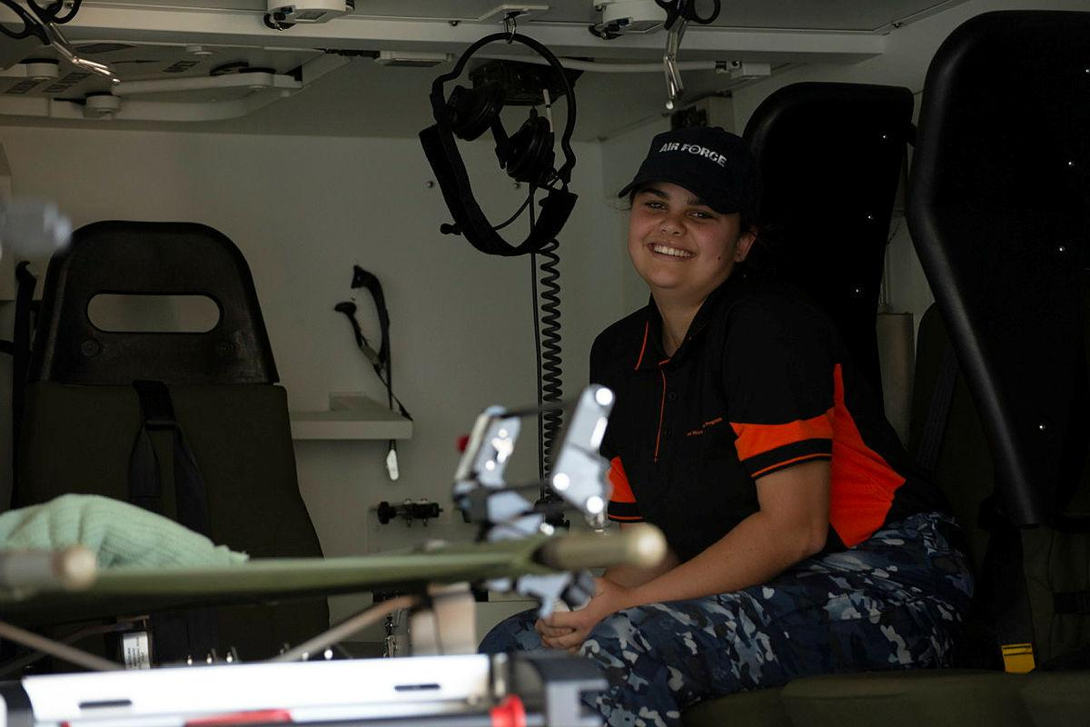 Indigenous Youth Program student Andrea Cole in a No. 1 Expeditionary Health Squadron Bushmaster ambulance during a visit to RAAF Base Townsville. Photo: Leading Aircraftwoman Annalin Wright