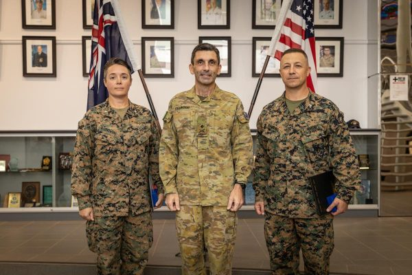 US Marine Corps' Lieutenant Colonel Amy Roznowski, left, Commander 1st Division Major General Justin Ellwood and US Marine Corps' Colonel David Banning at the presentation of the ADF Gold Commendations. Photo: Corporal Colton K Garrett US Marine Corps