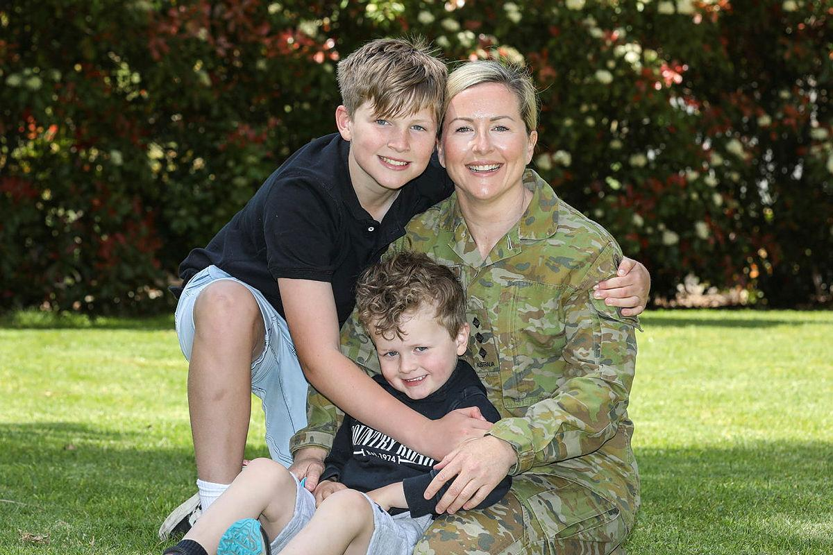 Captain Laura McCarthy is serving part-time under Service Category 3, and is pictured with her children at home. Photo: Corporal Brenton Kwaterski