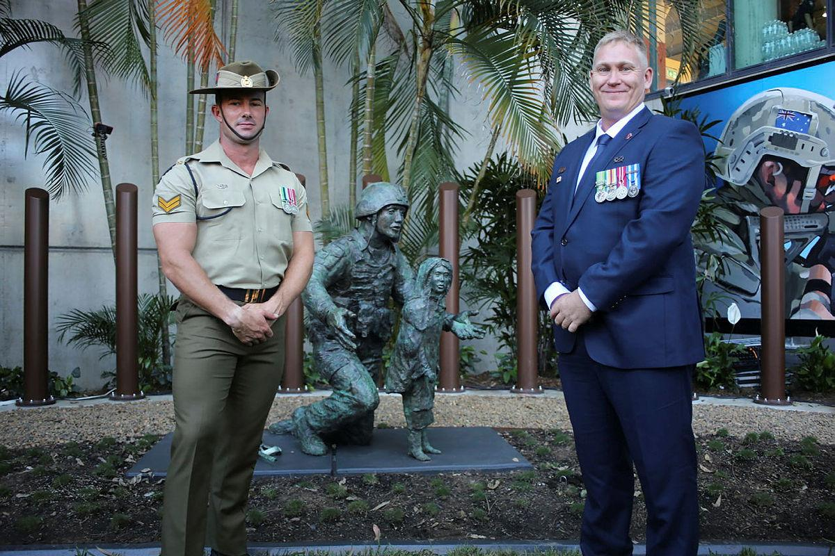 Corporal Ty Fergus, of the 6th Engineer Support Regiment, who helped build the Afghanistan War Memorial Gardenin Brisbane, with 42 for 42 Board Presidentand former combat engineer, Sean Mulqueen, at the memorial's opening.