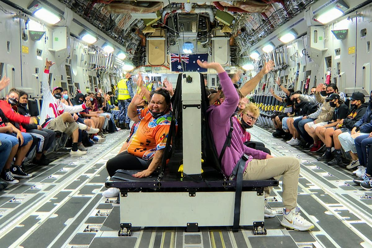 Ipswich Indigenous community members and children inside a C-17A Globemaster III for a flight from RAAF Base Amberley. Photo: Sergeant Peter Borys