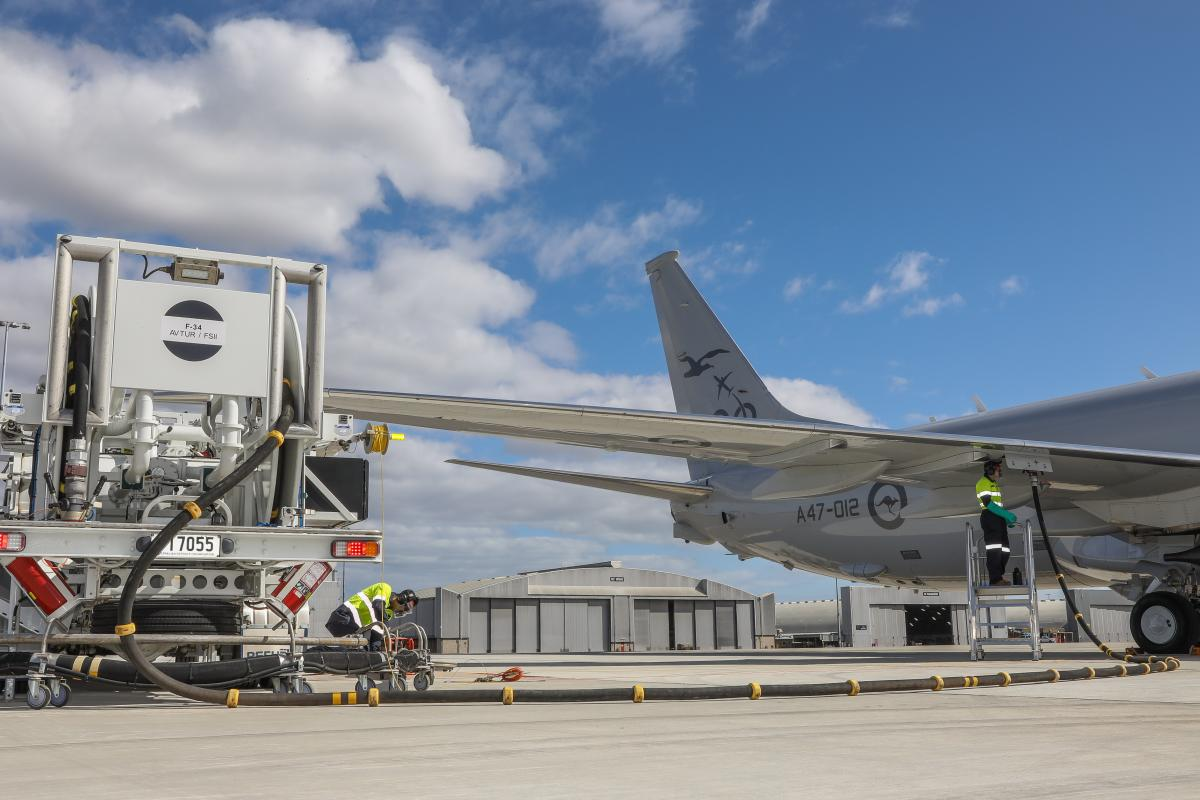 Leading Aircraftman Peyman Zeinali, left, and Leading Aircraftman Nicolas BallingaluseRAAF Base Edinburgh's in-ground refuelling system for the first time with an Air ForceP-8A Poseidon. Photo: CorporalBrenton Kwaterski