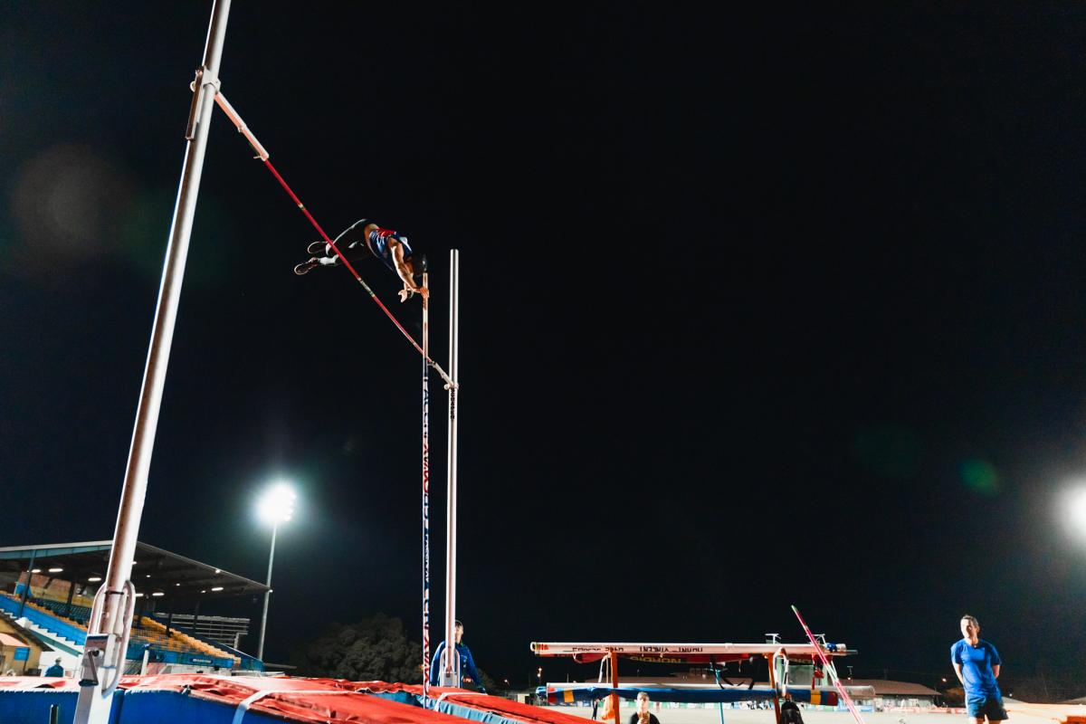 Corporal Brodie Cross clears the bar in the open men's pole vault at the Athletics NQ Championships in Townsville.