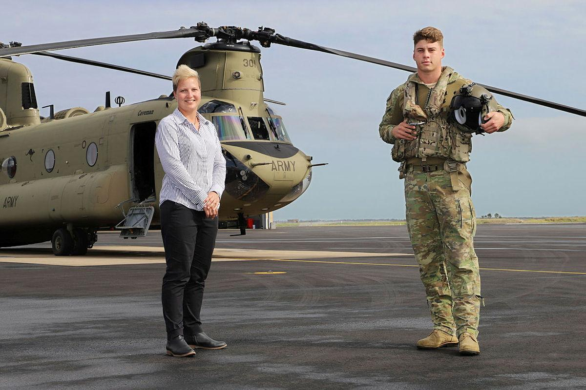 Townsville Defence Weather Service Office manager Krystelle Venn with 5th Aviation Regiment's Lieutenant David Selvage at RAAF Base Garbutt, Queensland. Photo: Lance Corporal Lisa Sherman