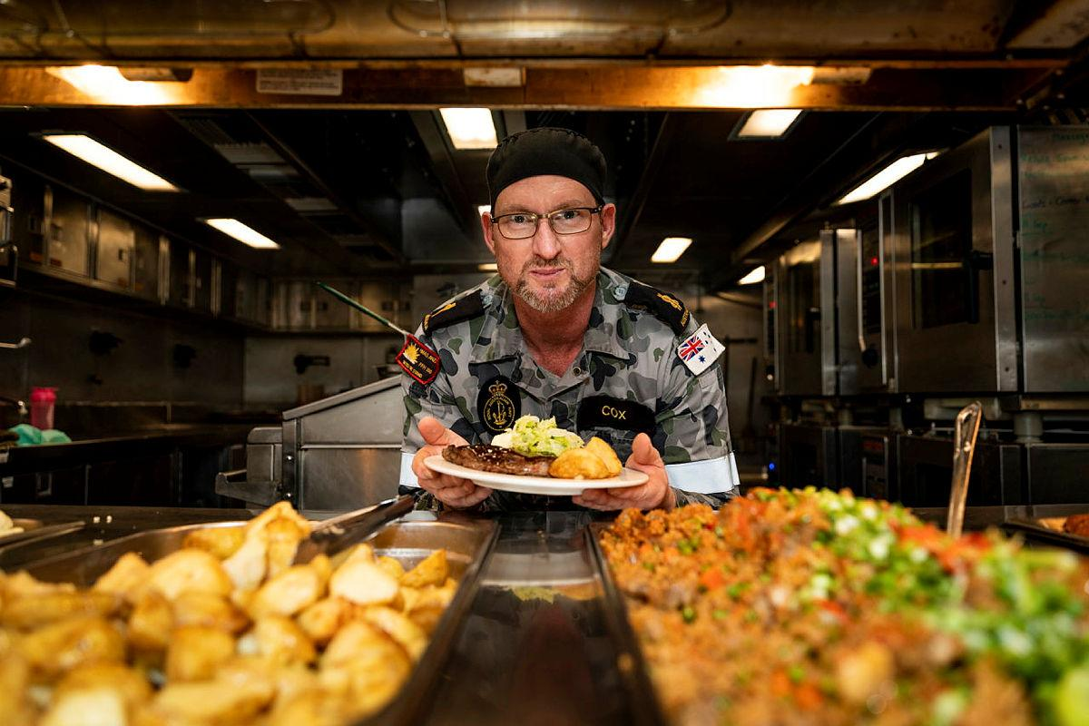 Able Seaman Clayton Cox prepares for dinner service in the galley on board HMAS Anzac during Indo-Pacific Endeavour 21. Photo: Leading SeamanLeo Baumgartner